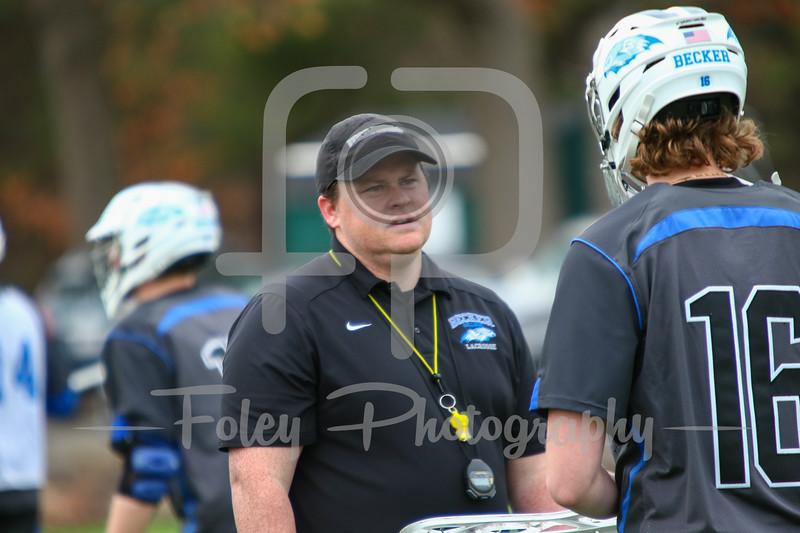 Becker College Hawks head coach Trevor Craven Becker College Hawks goalie Michael Krch (16)