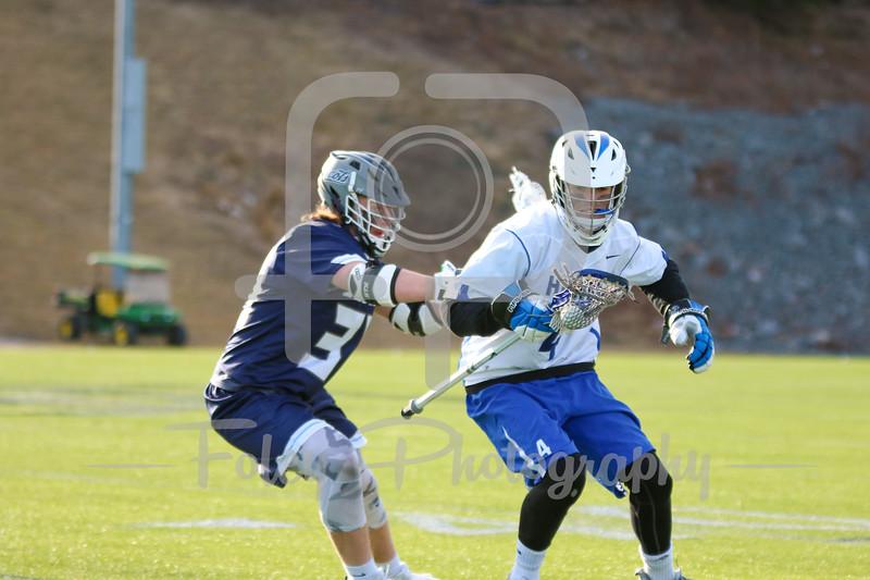 Becker College Hawks attack Daniel Johnson (4) Gordon College Scots Gabe Zornik (34)