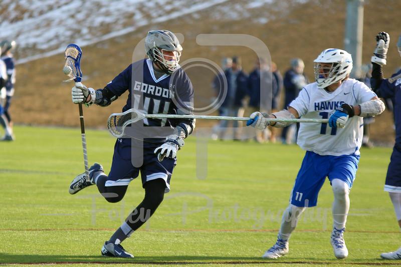 Gordon College Scots Thor Rasmussen (44) Becker College Hawks defender Lewis Jaworski (11)