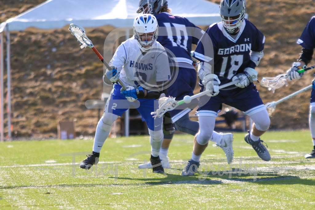 Becker College Hawks midfielder Blake Gordon (2) Gordon College Scots Mike Ritter (18)