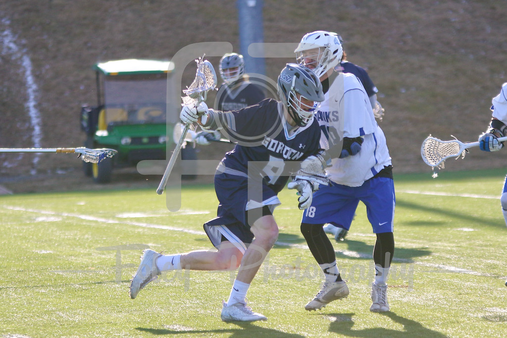 Gordon College Scots Nick Tozier (9) Becker College Hawks defender Bryan Parsons (19)