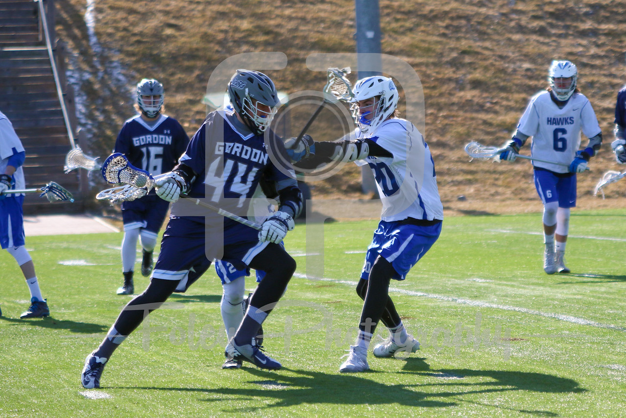 Gordon College Scots Thor Rasmussen (44) Becker College Hawks defender Corey Bebeau (20)