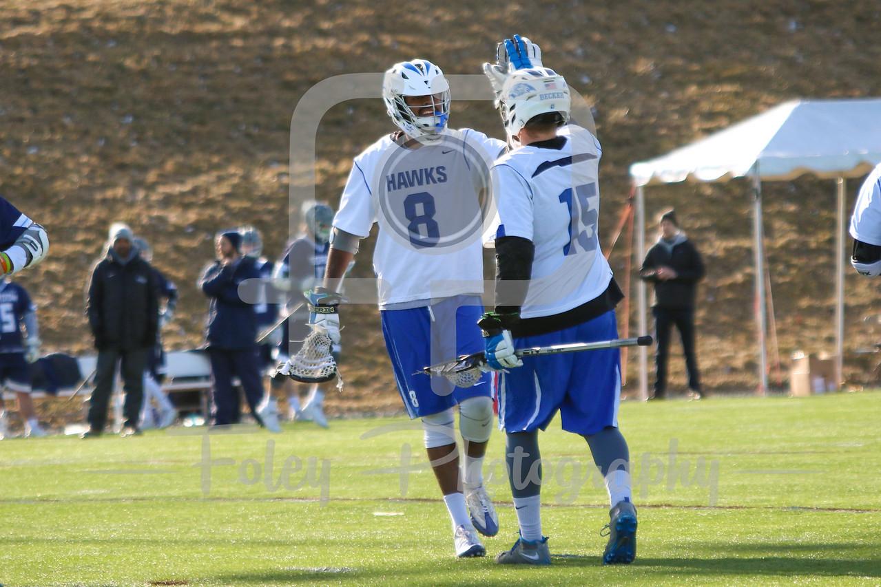 Becker College Hawks attack Avyay Chaganty (8) Becker College Hawks attack Blake Boutiette (15)