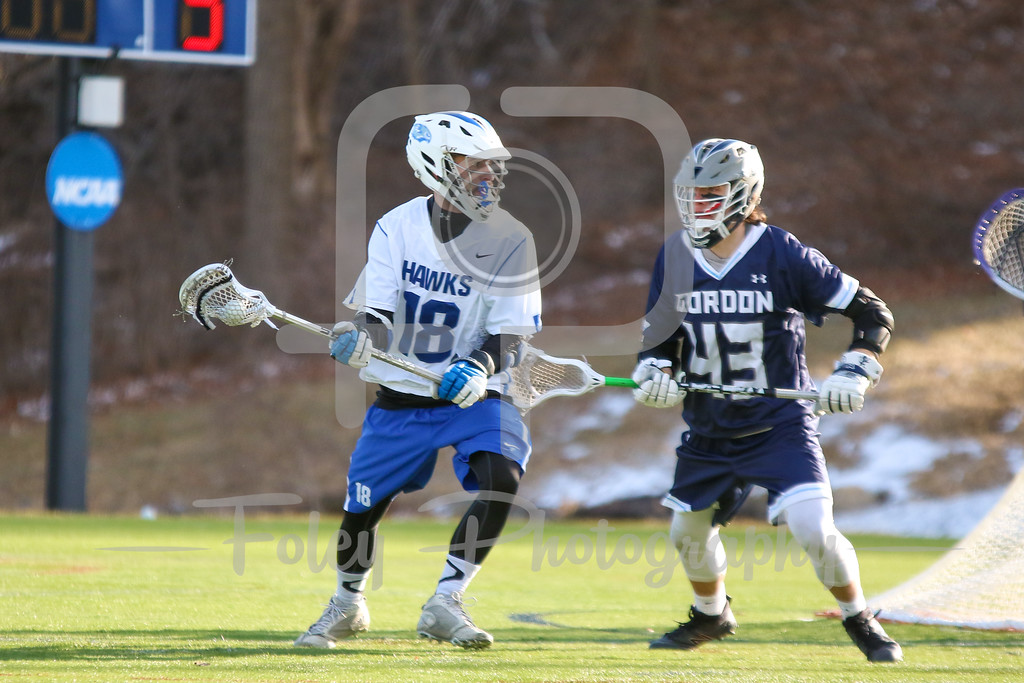 Monday, March 13, 2017; Leicester, MA; Becker College Hawks midfielder Matthew Genkos (18) is pushed by Gordon College Scots Jacob Hryzan (43) during the Scots 11-5 victory over the Hawks in a non-conference matchup.