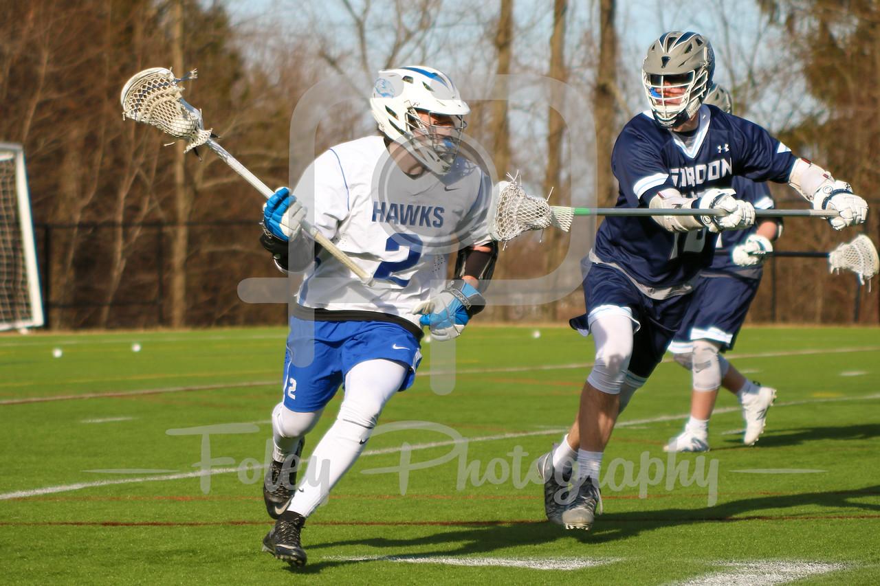 Becker College Hawks midfielder Blake Gordon (2) Gordon College Scots Mike Ritter (18)