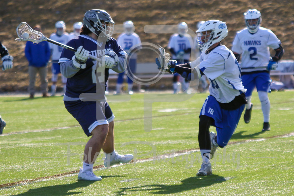 Gordon College Scots Jason Dantona (15) Becker College Hawks midfielder Matthew Genkos (18)