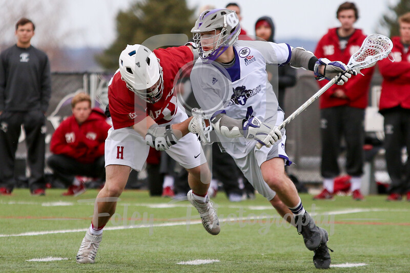 Holy Cross Crusaders attack/midfielder Sean Mullaney (4) Harvard Crimson midfielder Peter Blynn (10)