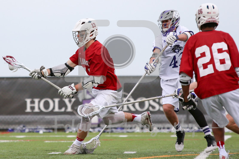 Harvard Crimson attack Morgan Cheek (13) Holy Cross Crusaders defender Parker Greiwe (43)