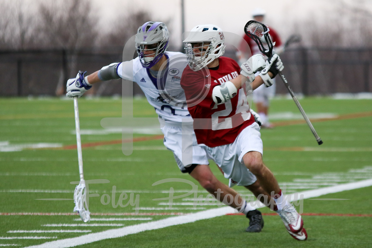 Harvard Crimson attack Joe Lang (24) Holy Cross Crusaders midfielder Marc Buermann (23)