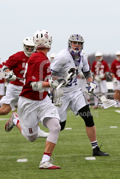 Harvard Crimson defender David Strupp (27) Holy Cross Crusaders midfielder Matthew Fischetti (24)
