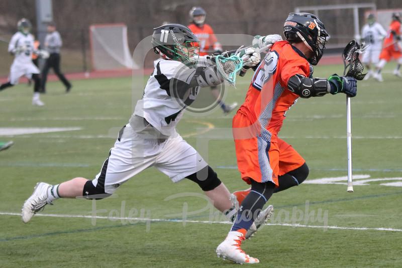 Nichols College Bison attack Matt Feigenblat (11) Salem State Vikings midfielder Craig Gordon (13)