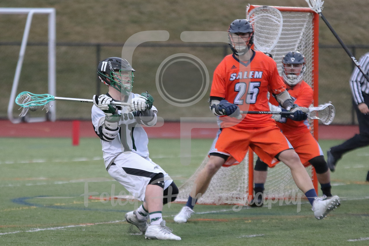 Nichols College Bison attack Matt Feigenblat (11) Salem State Vikings midfielder Travis Kneeland (25)