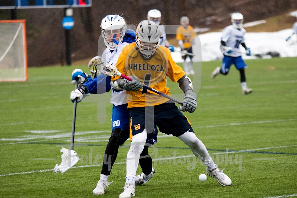 Wheelock College Wildcats Noah Horning (1) Becker College Hawks defender Corey Bebeau (20)
