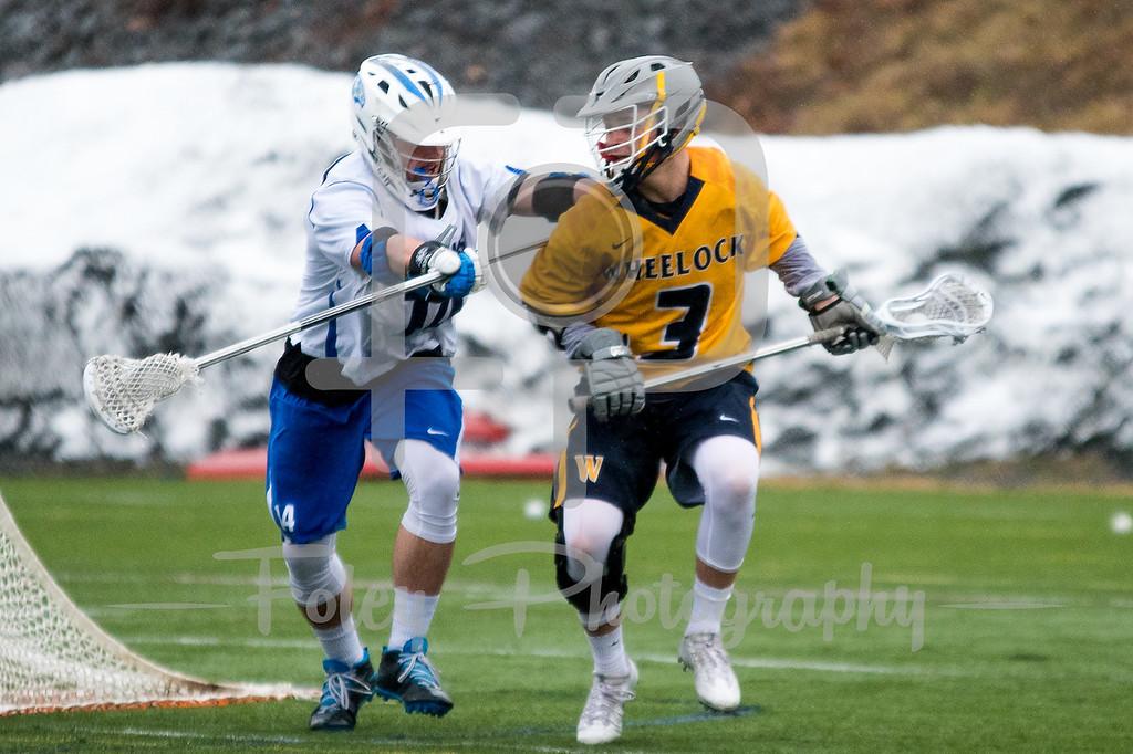 Wheelock College Wildcats Jared Trainor (3) Becker College Hawks defender Nicholas Mariano (14)