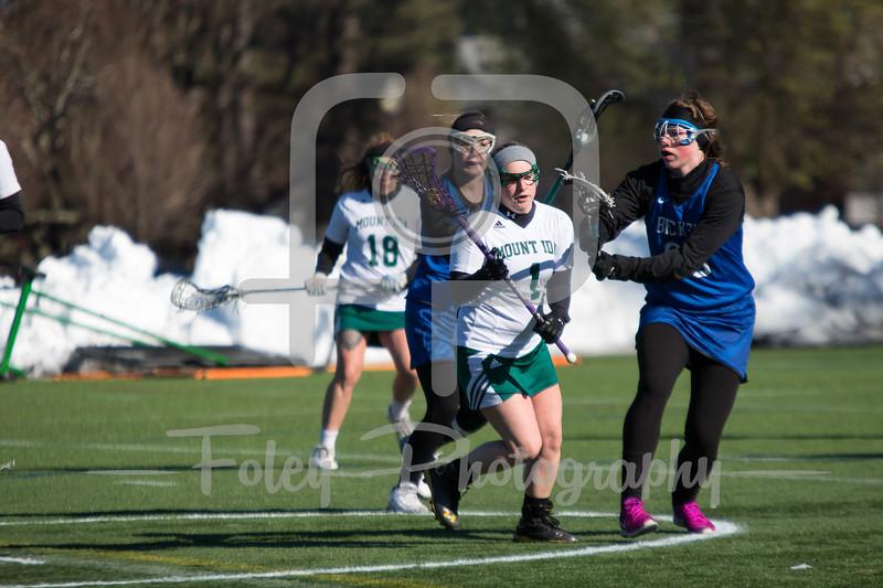 Mount Ida Mustangs Hayley Napier (1) Becker College Hawks midfielder Marissa Turner (23)