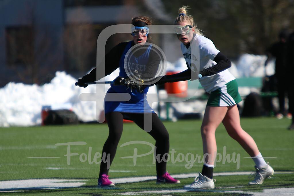 Becker College Hawks midfielder Marissa Turner (23) Mount Ida Mustangs Brooke Scahill (13)