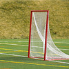 Red lacrosse net with white netting on artificial turf