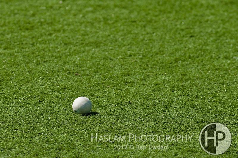Gray lacrosse ball on grass