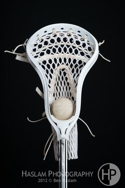 A single lacrosse head with a single ball