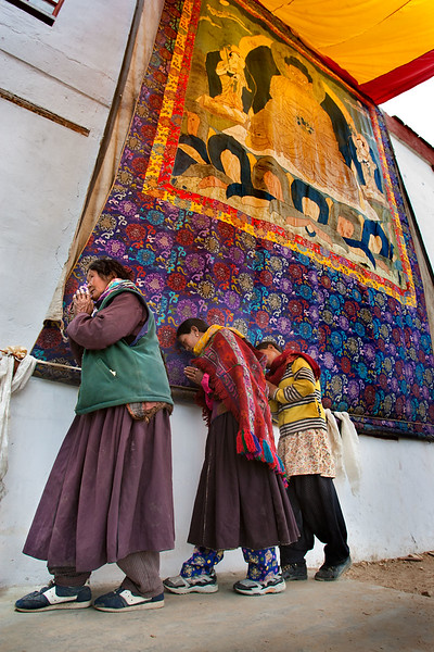 Touching the Thangka with the forehead. Korzok Monastery. Tso Moriri.