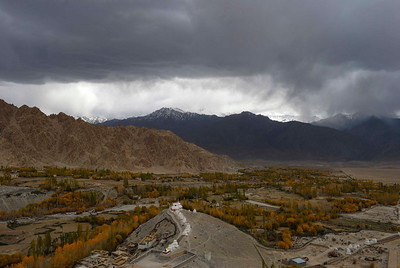 Snow storm descends over the Indus seen from roof of Phyang monastery