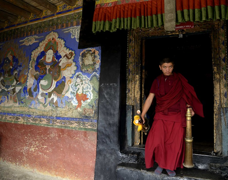 Monk comes out of the main temple at Thiksey
