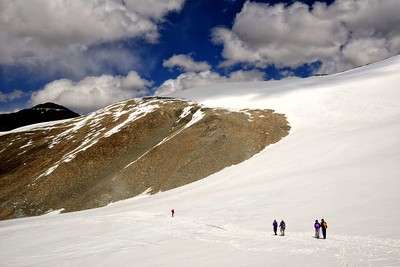 Descending the snowfield from the top of the Lasermo La in Ladakh
