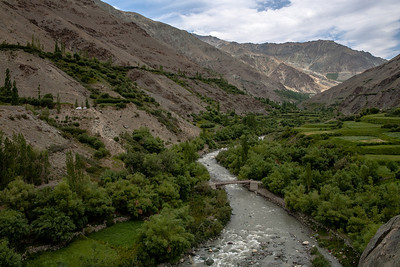 Around 40km after Kargil, Sankoo is a stepping stone to head deep in the Suru valley. It is surprisingly green for its altitude, of over 3000 mt, thanks to the Suru river that flows through it. A zig zag road follows this river, crossing several bridges, as seen above, to cross the Suru valley through villages like Sankoo, Panikhar, Tangole and Parkachik, where suddenly, civilisation comes to a halt!