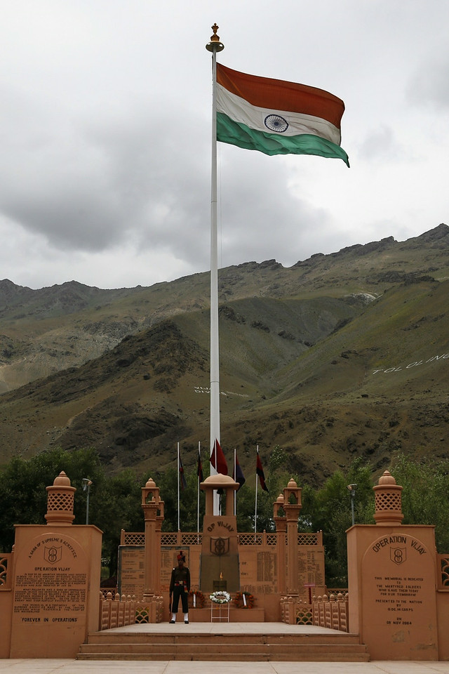 The Indian tricolour at the Kargil War Memorial sways with the breeze in the backdrop of the Tololing mountain range in Dras.