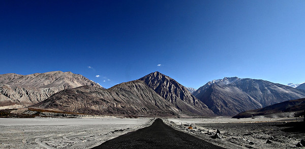 Nubra Valley - an arrow straight road leads one to the army checkpost on the other side of the valley...