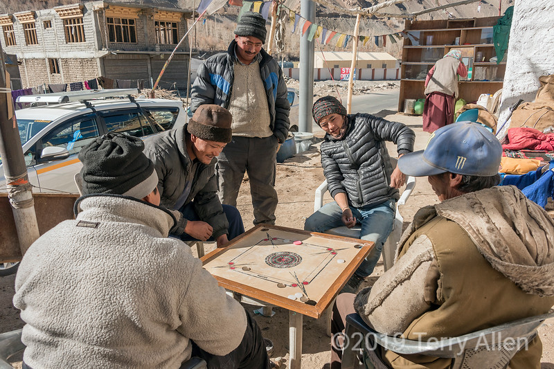 Local men playng carrom (karom, karrom) board game, Karu, Leh Manali Hwy, Ladakh