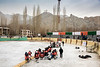 Internission, Ladakh women's hockey team, 5th Hai Hockey Championship, with Maitreya temple on hill, Leh, Ladakh