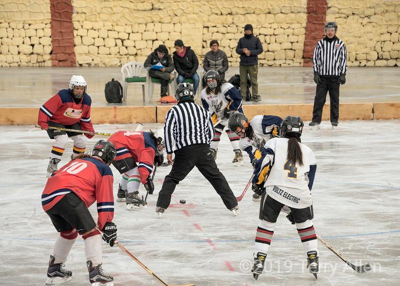 Referee dropping puck, Ladakh women's hockey team, 5th Hai Hockey Championship, Leh, Ladakh