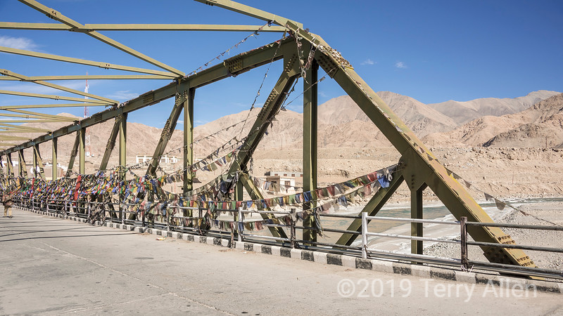 Upshi bridge across the Indus River, festooned with prayer flags, Keylong-Leh Road, Ladakh, India