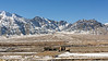 Farmstead in winter with forage stored on roof, Indus River Valley, Stok Range, Stakna, Ladakh