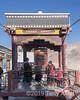 Tibetan grandmother with two grandchildren turning the giant prayer wheel, Shituk Gompa, Leh District, Ladakh