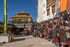 Huge number of festival goers cram the courtyward of Spituk Gompa for the Situk Gustor festival, Leh District, Ladakh