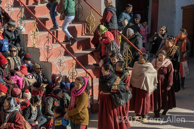 Local people arriving in the courtyard for the Gustor festival, Spituk Gompa, Leh, Ladakh
