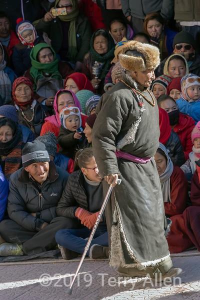 Elderly man in traditional fur hat and sheepskin coat, Gustor festival, Spituk Gompa, Leh, Ladakh