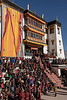 Crowds in the courtyard during the Gustor festival, vertical, Spituk Gompa, Leh, Ladakh