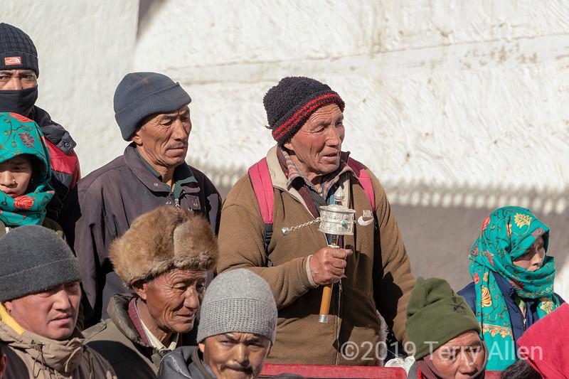 Man twirling silver prayer wheel, Gustor festival, Spituk Gompa, Leh, Ladakh