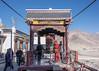Buddhist monk turning the giant prayer wheel, Spituk Gompa, Leh district, Ladakh