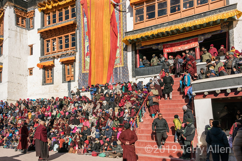 Crowds of Spituk Gustor festival goers in traditional attire crowd into the Spituk Gompa for the annual festival, Leh District, Ladakh