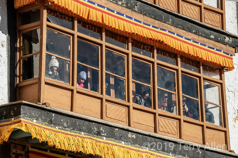 Spituk Gompa window with Gustor festival watchers, Leh, Ladakh
