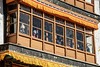 Spituk Gompa window with Gustor festival watchers, Leh, Ladakh