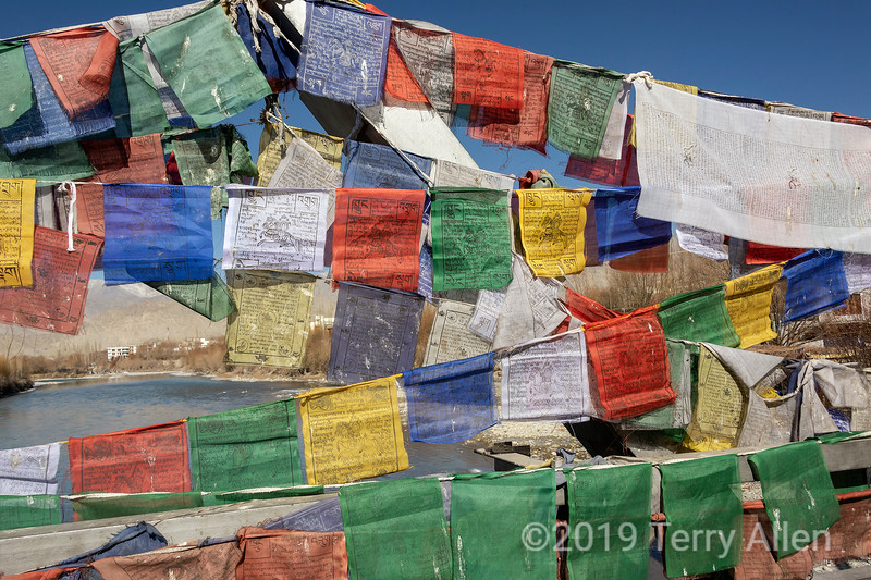 Prayer flags on the Chuckhot Rd bridge across the Indus River, Leh, Ladakh