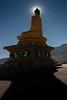 Backlit Gautama Buddha with sun halo, Stok Gompa, Ladakh