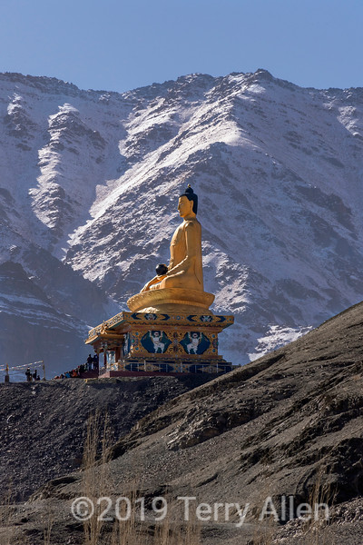 Stok Buddha with mountain backdrop, Stok, Ladakh