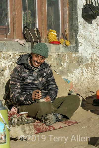 Ladakh man felting snow leopards by his house, Ulley, Ladakh