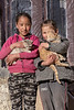 Two Ladakh girls cuddling their pet cats, Ulley, Ladakh